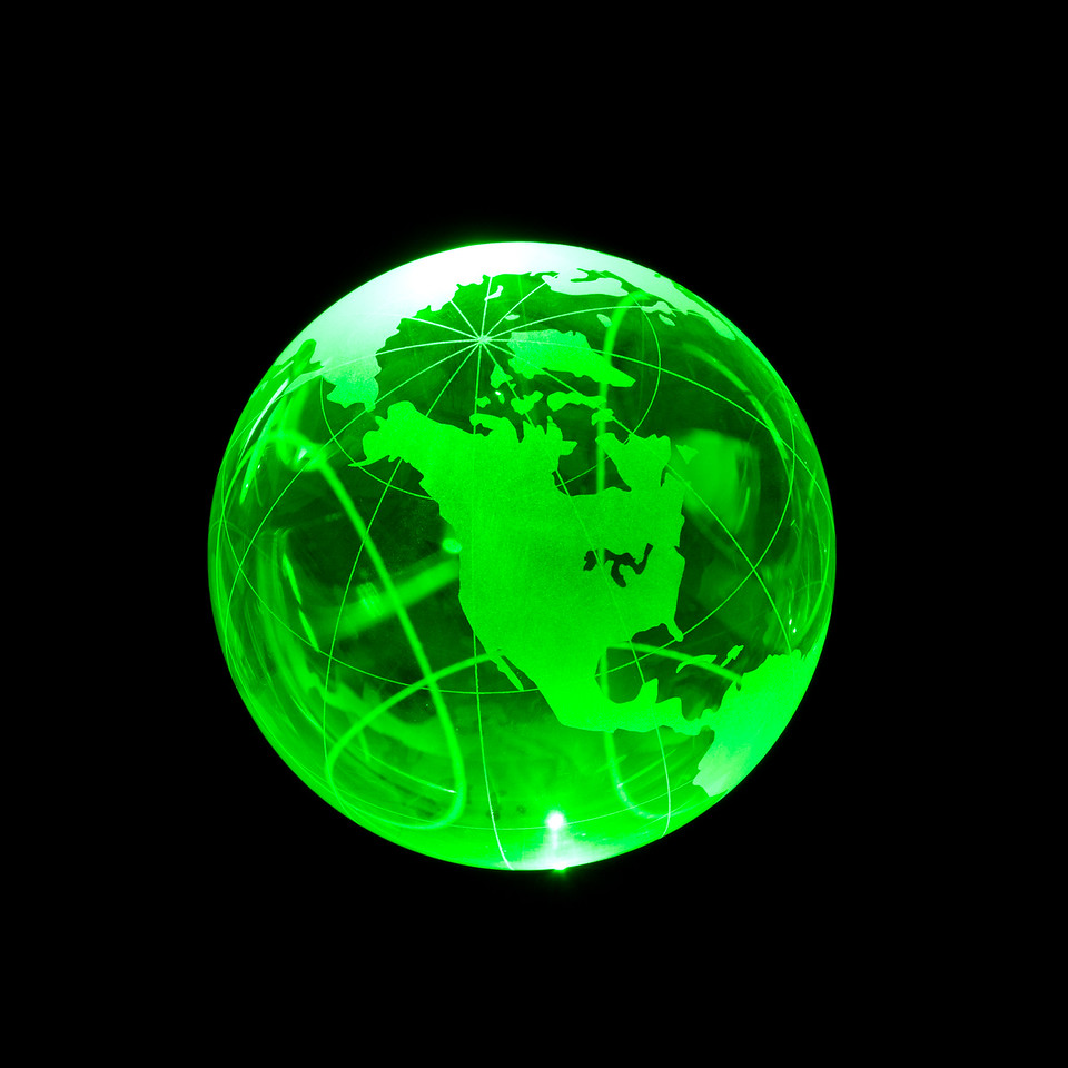 green laser illuminating a glass globe