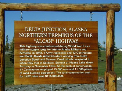 Sign explaining the location of the northern end of the Alaska Highway.