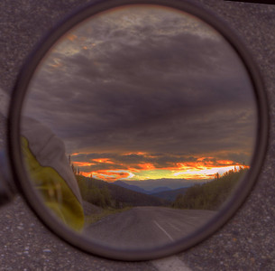 The image in the mirror is to the northeast, with the sun rising above mountains at 3:50 AM.  Around Mile 68 on the Tok Cut-Off - just returning from a ride to Fairbanks the previous afternoon.