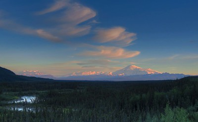 A view of (from right to left) Mt Sanford, Mt Wrangell, and Mt Bona near sundown from around MP 71.