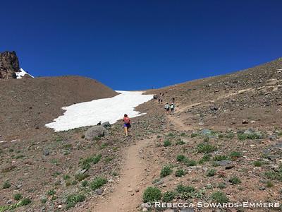 Climb past the lake to gain the ridge.