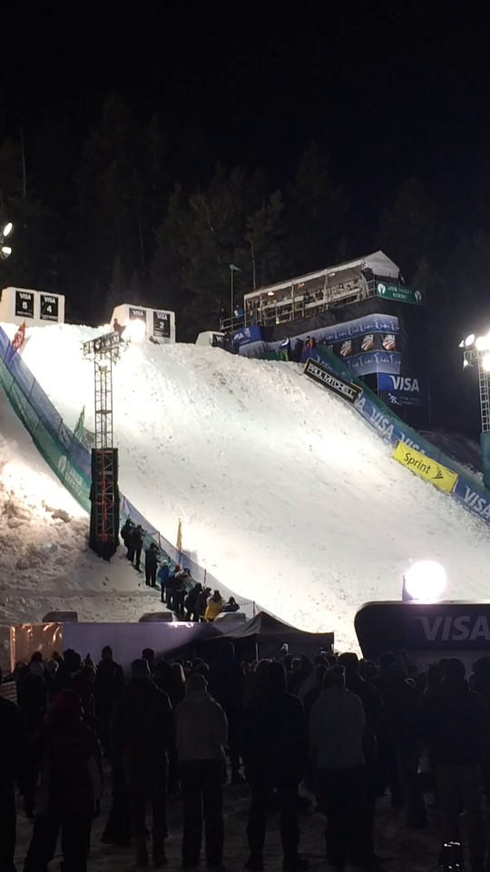One of the skiers lands their jump.