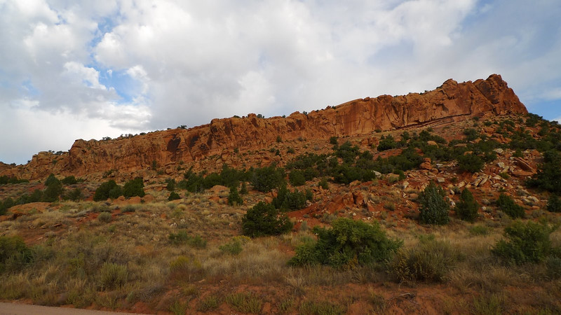 Wide shot of the rock outcrop with most of the glyphs.
