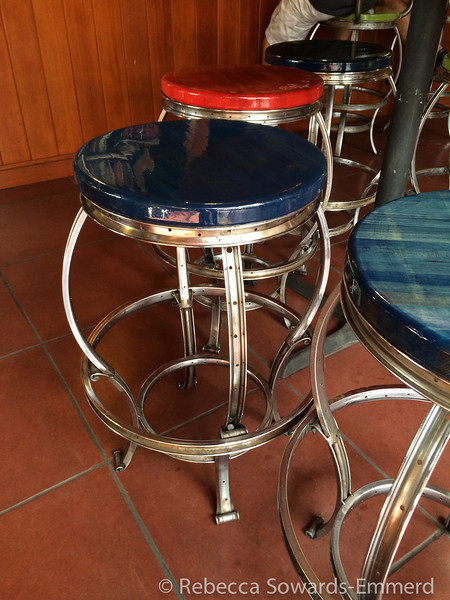 I think everything here is made from repurposed bike parts. The frames of the stools and tables were old wheel rims.