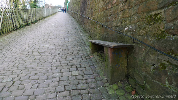 It's a steep path - the bench isn't crooked, it's level.