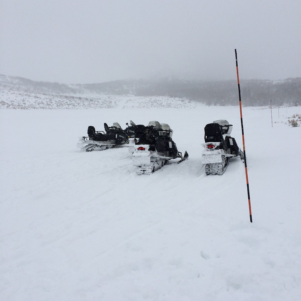 Next, we snowmobile out to do some archery. My first time driving one.