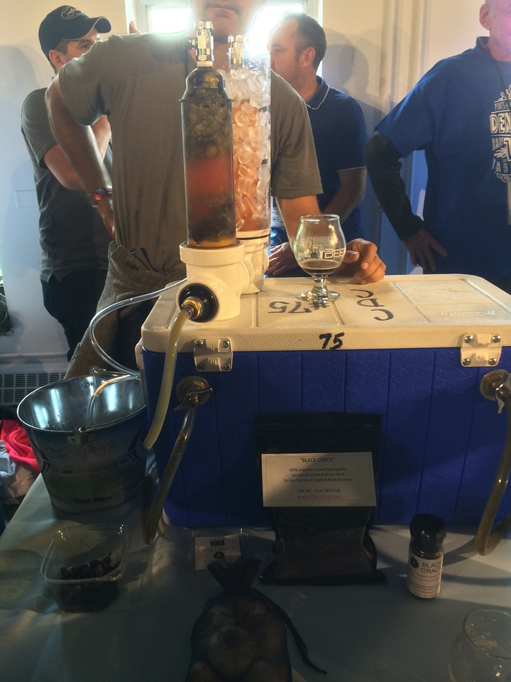 Here, Sam Calgione from Dogfish Head pours 120 minute IPA through a randall with cascade hops and black garlic. Better than it sounds.