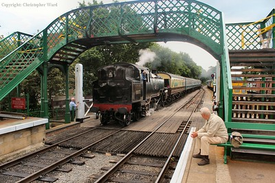 80072 passes under the footbridge