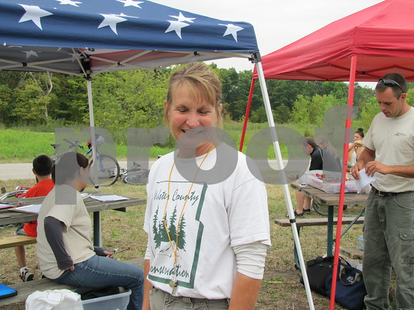 Karen Hanson with Webster County Conservation at the registration booth for the Adventure Race.
