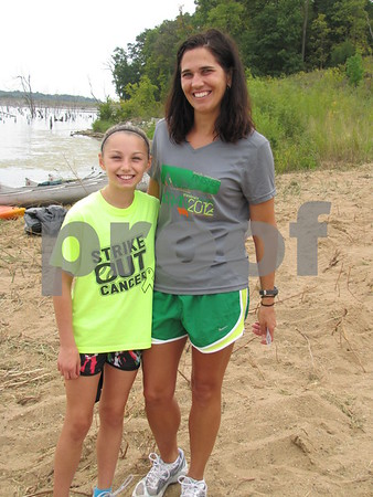 Abby and Sharon Landwehr were there to cheer on dad/husband Mike Landwehr.