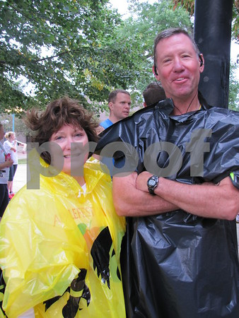 Volunteers for Applefest 5K Laurie and Steve Hendricks are prepared for the rainy forecast.