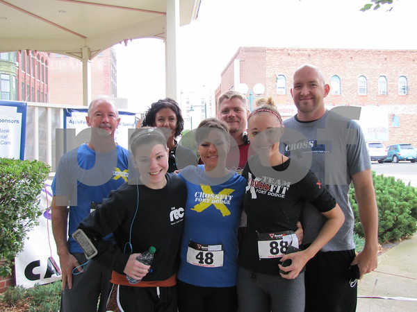 Mark Gleason, Anne Dorage, Ryan Agnitsch, Andy Newell, and in front Sarah Laborde, Jennifer Newell, and Stacy Agnitsch before running in the Applefest 5K/10K.