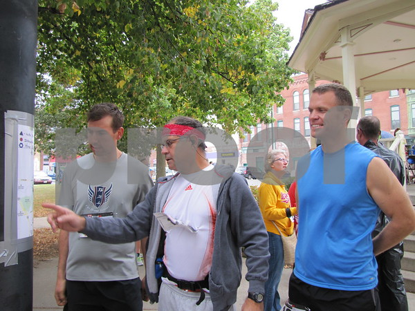Travis Jass, John Justice, and Jason Hamilton go over the route for the Applefest 10K.