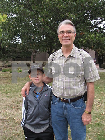 Peyton Hays and grandpa, Ken Hays, were there to cheer on runners at Applefest 5k/10k.