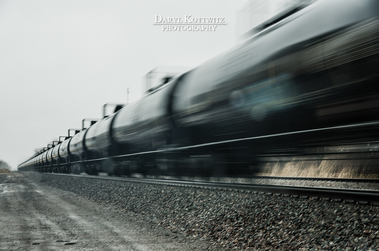 """""""Rollin' Railroad"""" shot in Ames, NE.  I purposely used a slow shutter speed to get the blur.  I should have used a tripod to get stationary objects sharp, but didn't have time.  Plus, it was raining and I didn't want to get too wet!"""
