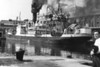 A scene at the Swansea North Dock basin in 1949 with SS Flora leaving a plume of smoke as it raises steam alongside the Weaver's building, nowadays this is approximately the site of Sainsbury's car park. This ship was possibly the 1936-built M.V. Flora - 2642 GNT, flying the Panamanian flag and owned by Oceanways Co. Inc. The vessel was fitted with new engines in June 1958.