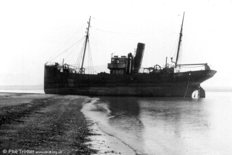 The Tenby Castle aground. Condemned to the breaker's yard, she was being towed to Messrs T W Ward's basin at Briton Ferry when she was swept aground by a 25 foot tide on a Sunday morning in 1960, two miles from her destination, at the entrance of the river Neath.<br /> One of the famous 'Castle' trawlers, the Swansea-based 'Tenby Castle' was built for Consolidated Fisheries in 1928 by Cochrane & Sons of Selby. She was requisitioned for war service as the minesweeper HMS 'Sawfly' during the Second World War, after which she returned to her base at Swansea. The 'Tenby Castle' was sold to Peter Hancock & Sons of Milford in 1956, and scrapped at Briton Ferry in 1960.