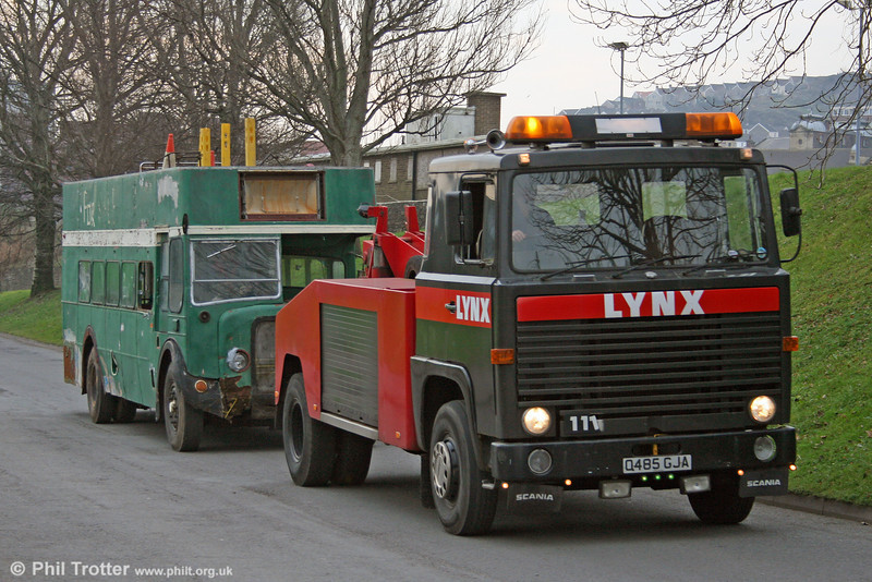 Q485 GJA, a Scania 111 tow truck with Lynx Express, Skewen, seen in Swansea on 7th January 2006.