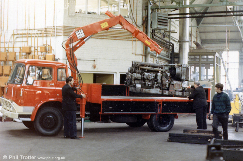 A sparkling SWT Bedford TK stores lorry fitted with HIAB, new in 1970 at Ravenhill depot. The power unit being lifted is from a Leyland Atlantean.