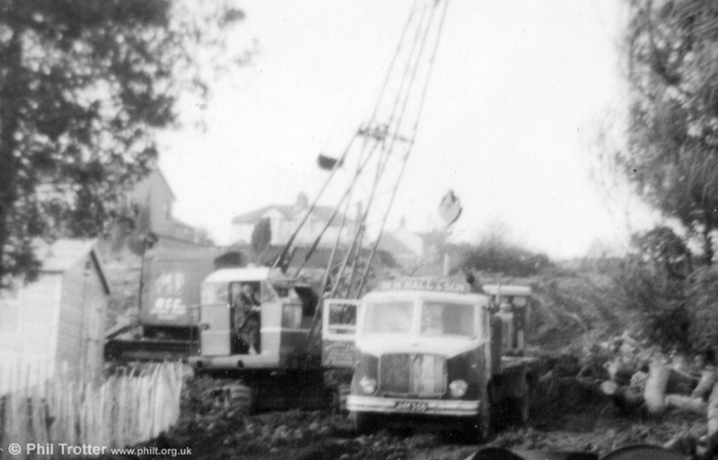 An AEC Mercury in the service of W. H. Hall & Son during housing development in the Tycoch area of Swansea during the mid-1960s. The registration appears to be JKM or JMH 256 or 268. A once everyday scene of an AEC at work!