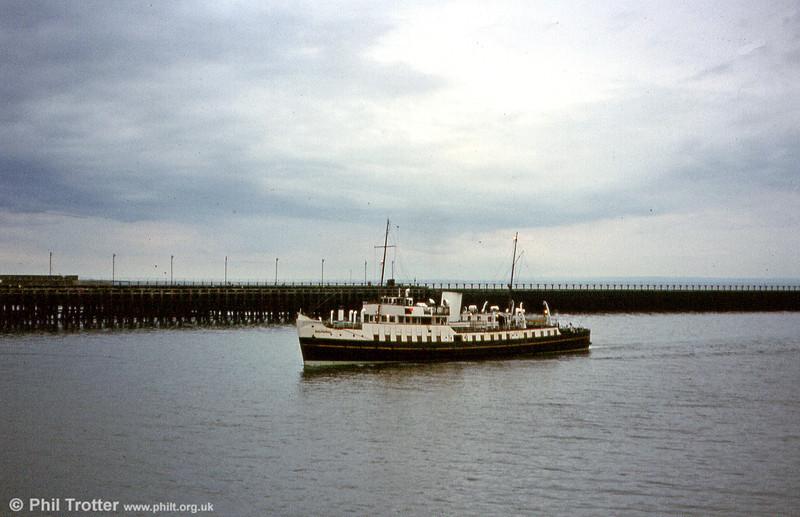 MV Balmoral slips into Swansea at dusk.