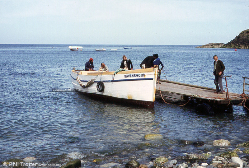 One of the small boats used to ferry passengers from ships to Lundy Island, arrives at the beach.