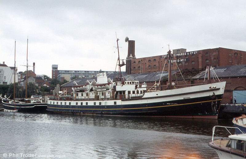 In full White Funnel colours, this is MV Devonia laid up at Bristol. Built in 1956 as the Scillionian, operating between the Isles of Scilly and Penzance. The ship was sold to Campbells in 1977, eventually sold to Torbay Seaways ('Devonian'), Norse Atlantic Ferries, and renamed 'Syllingar', then to several subsequent owners before being abandoned in Bourgos, Bulgaria, where she later sank.