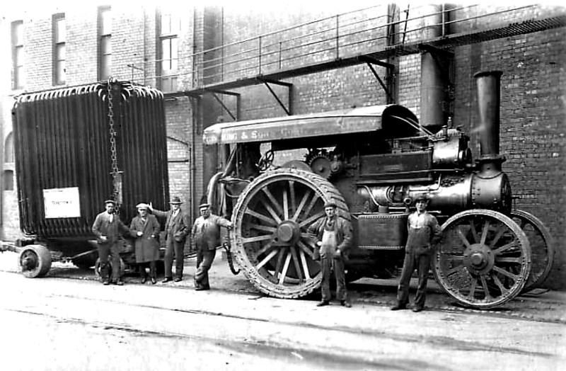 An archive shot showing a Fowler 'Lion Class' engine, 'Lorna Doone', built in 1914 and owned by Greening and Sons of Killay, Swansea. The picture is believed to have been taken around 1929 and shows the locomotive towing a transformer at the BTH yard in the Strand, Swansea.