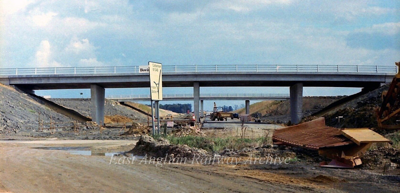 The view looking east from a point west of the Histon bound flyover. The road sign and the old route of the B1049 stretch of road have only weeks left before they become part of the A14.  27th October 1978.