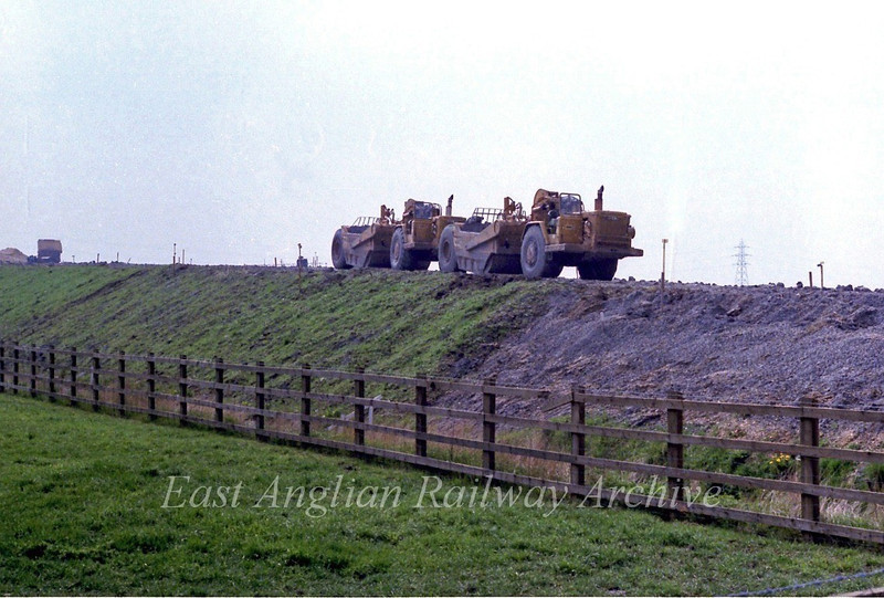 Two earth movers rest from work on the Cambridge bound new route of the B1049 up to the flyover. 23rd April 1978