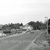 The first sign of work starting on the A14. This the old B1049 road looking towards Histon. The current flyovers are in the field to the right behind the fence. The centre line of the A14 passes from left to right where the road sign is in the distance.  24th October 1976.