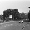 The old route of the B1049 into Cambridge  looking towards Histon with fields on both sides of the road. The A14 dual carriageway will cross the road here from left to right with the signpost marking the centre line of the road. The car is standing about where the Westbound slip road will be.<br /> 1st September 1976.