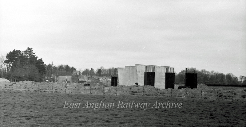 Work in progress on the Histon bound flyover support piers.  17th April 1977. Cambridge Road Impington on the left.
