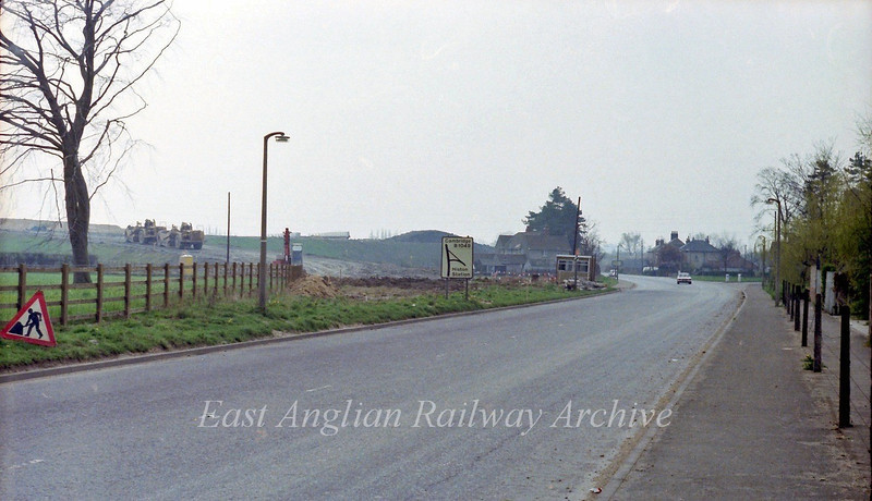The old route of the B1049 looking towards Cambridge with the new route up to the flyover under construction.  23rd April 1978