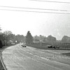 Although the negative has somewhat deteriorated, this is the scene before any work took place on the A14. The area has changed beyond all recognition. The view is looking towards Histon from near the old Arbury Road Junction with the old route of the B1049. No parts of this road are still in use as a main road, but it is is still there with access through a gate.. The A14 flyovers will be built in the fenced off field to the right which at the time contained sheep. The new current route of the B1049 will be built to the right of the picture running down from the flyovers. The only landmark which is still in place today is the house to the right of the large conifer in the middle of the picture which is in Cambridge Road Impington, but now the other side of the dual carriageway.  Picture dated 22nd February 1976.