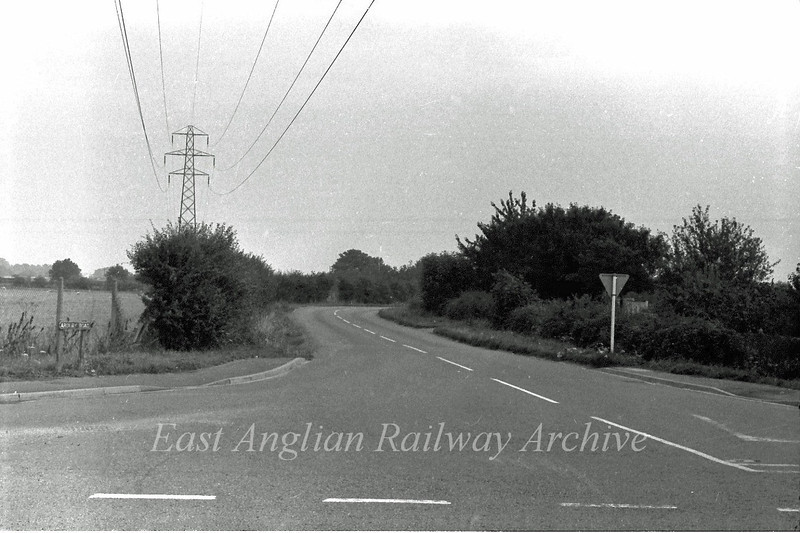 The old Arbury Road junction with the old B1049 facing Arbury. Looking towards the right from the next photo. The new road now crosses the picture about where the bend is. The scene is totally unrecogniseable today.  August 1975.