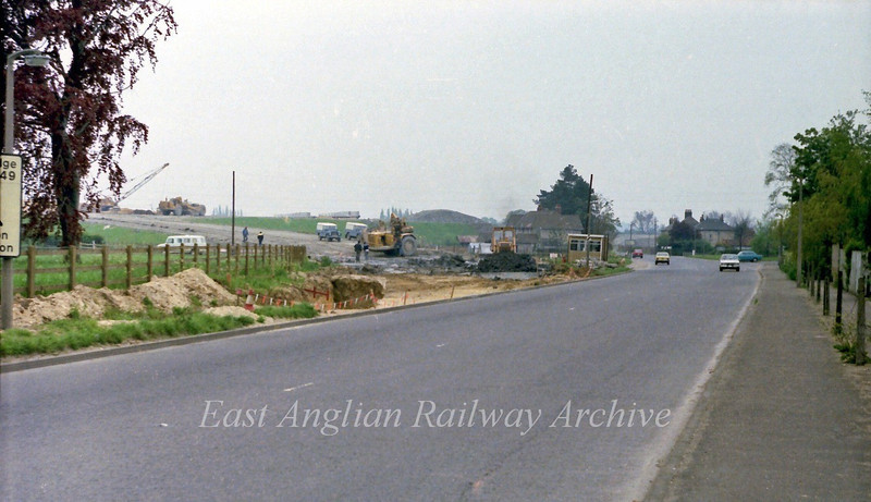 The old route of the B1049 to Cambridge with the new route up to the flyover under construction.  21st May 1978.