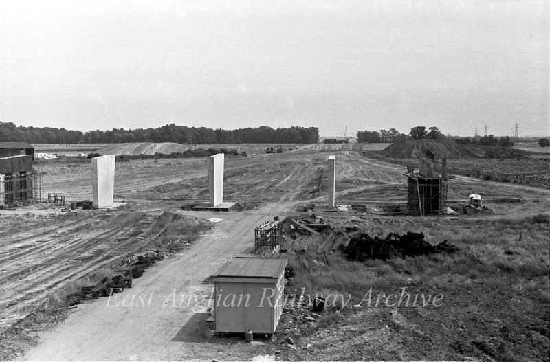 This was the view looking east towards Milton from the Histon bound flyover. The supporting piers for the Cambridge bound flyover have been completed. The gap in the treeline in the distance is where the A14 crosses the railway line, now the guided busway.  17th July 1977