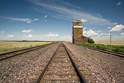 Abandoned grain elevator on the flat prairies of Montana.