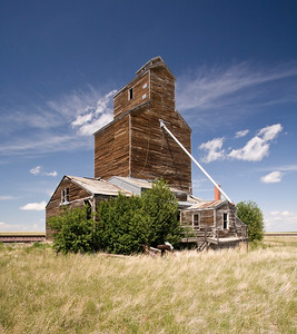 Abandoned grain elevator on the flat prairies of Montana.