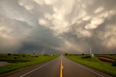 Wind turbines on the Prairie Winds Turbine Farm, near Minot, North Dakota.  Interesting clouds are mammatus clouds, sometimes seen after a passing thunder storm.