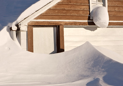 The snow shovel is in the garage.