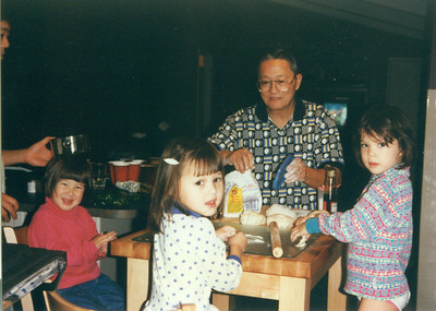 PaPa Chen and granddaughters making potstickers