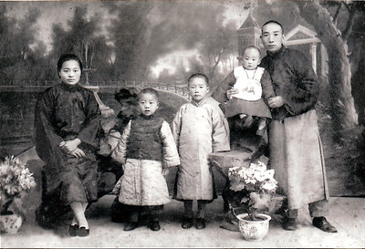 PaPa Chen (infant), and family. Beijing, China, circa 1930.