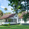 "Home of  Marjorie Kinnan Rawlings, Cross Creek, Florida. Ms. Rawlings was the 1939 Pulitzer Prize -winning author of ""The Yearling."" Note: the green oranges on the tree in foreground."