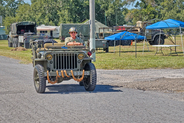 M.P. Driving Army Jeep