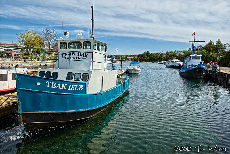 This must be the Teak Isle.  Probably owned and operated by Teak Bay charters.  Shot in Big Tub Harbour in Tobermory, Ontario in 2007.