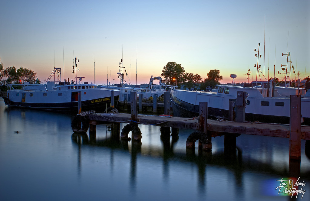 Dusk on the Port Dover harbour.  A few unique Lake Erie fishing boats that make up part of the worlds largest freshwater fishing fleet.
