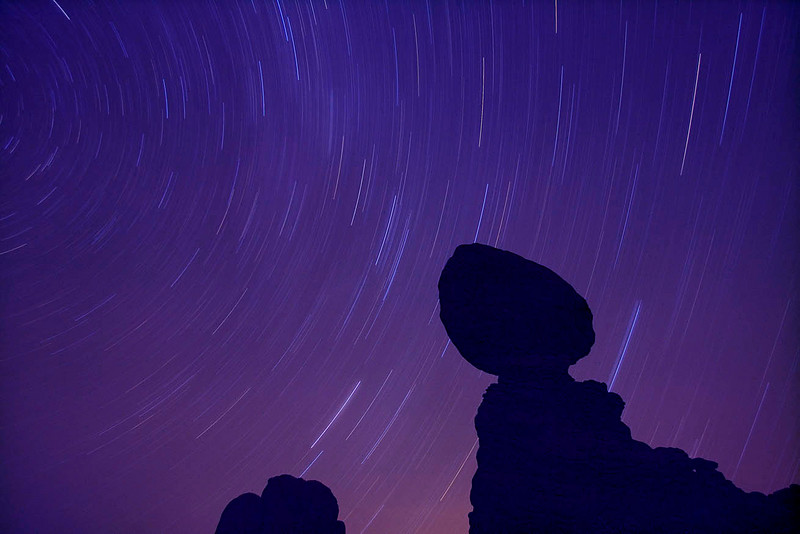Star trails over Balanced Rock - Arches N.P. - The night sky, unincumbered by competing city lights, is perfect for star gazing.  You can easily see, spanning the sky like a cloud of light, the region known as the Milky Way.  To get the star trails I left the shutter open for 50 minutes. With no other souls around it seemed that we had the Park all to ourselves.