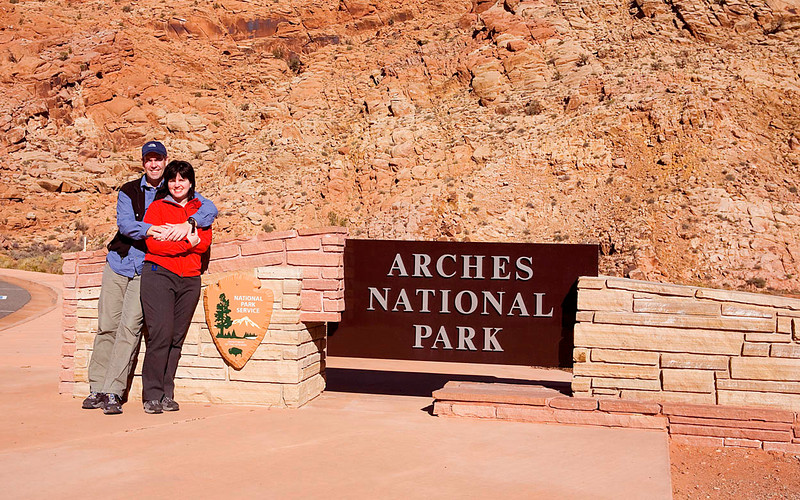Us at the entrance to Arches National Park.